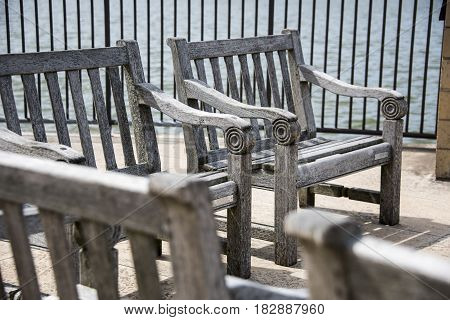 The old wood chair in the park with lake view
