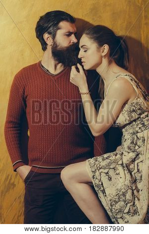 Pretty Girl With Closed Eyes Leaning On Serious Bearded Man