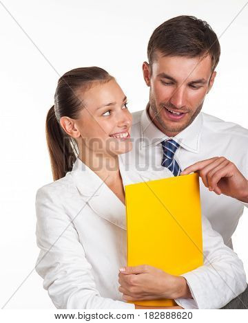 Manager with documents in his hands flirts with a colleague