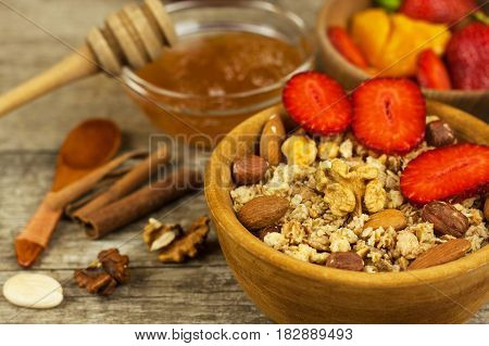 Oatmeal with strawberries. The concept of healthy eating. An exquisite snack for athletes. Vegetarian food
