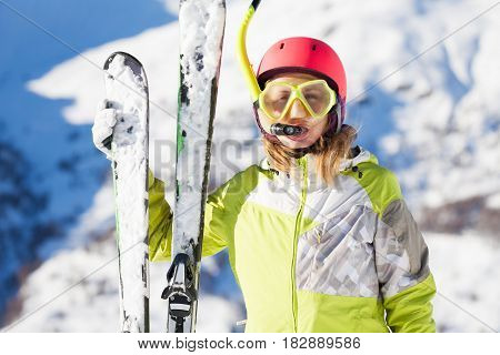 Funny portrait of female skier in diving mask and snorkel