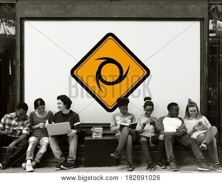Group of Friends Sitting Together with Sawblade Attention Banner Behind