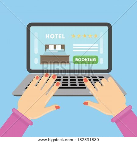 Online hotel booking. Female hands typing on the laptop to book a roomin the hotel.