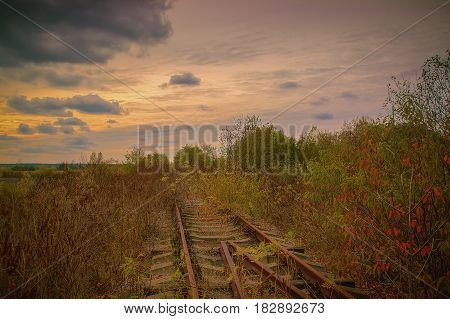 Old Abandoned railway in the autumn evening