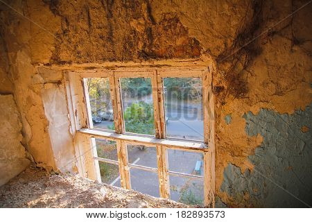 Walking through demolished house at evening light