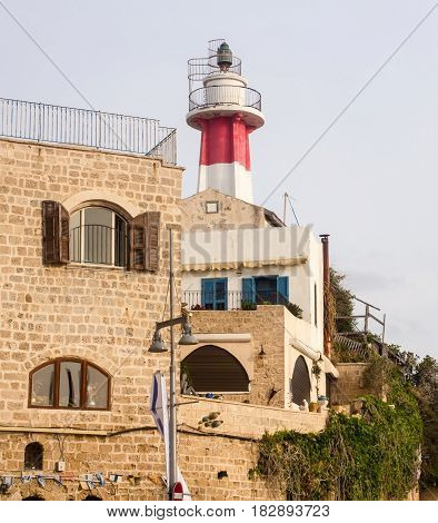 Red and white Old inactive Lighthouse on a hilltop above the old Jaffa Port Israel Mediterranean
