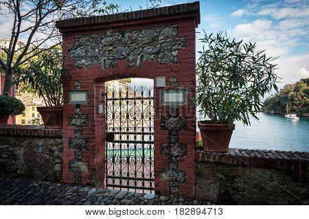 Ancient brick gates on hill near Portofino town, Italy