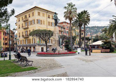 SANTA MARGHERITA LIGURE, ITALY - DECEMBER 2016: People ner monument of Victor Emmanuel II in Santa Margherita Ligure town, Italy