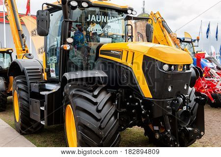 RIGA, LATVIA - APRIL 2017: JCB Fastrac4220 tractor and other construction equipment at the public event of Riga Machinery Sales.