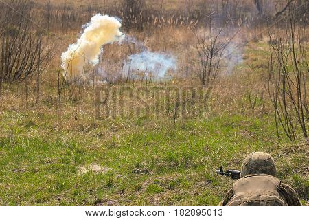 Front Line. Military attack on battlefield with gun from ambush