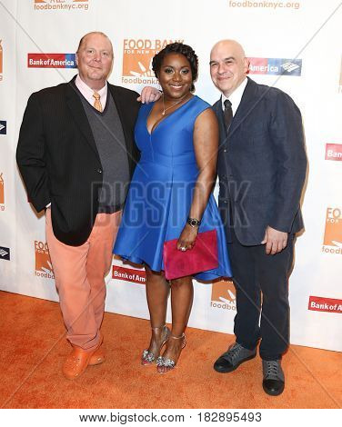 NEW YORK-APR 19: (L-R) Mario Batali, Margarette Purvis and Michael Symon attend the Food Bank for New York City's Can-Do Awards Dinner 2017 at Cipriani's on April 19, 2017 in New York City.