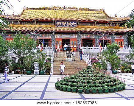 Lantau, Hong Kong - March 24, 2003: Many people visit the Po Lin Monastery on the island of Lantau in Hong Kong.