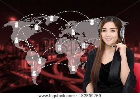 portrait of asian woman support phone operator or call center in headset sitting on red chair with global media connection on red blurred night city background customer support and service concept.