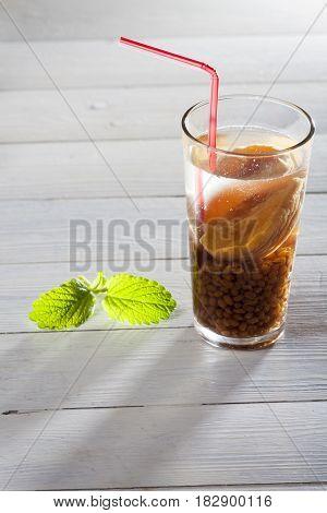 chilenian mote con huesillos drink on white wood