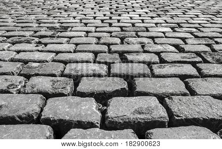 The road paved with stone. road of massive stone blocks