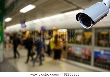 cctv security camera with abstract blurred subway station background color tone effect security technology concept.