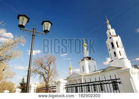 Orthodox church and lantern at clear blue sky in early spring