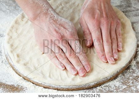 Homemade pizza prepare dough hand topping. Food.