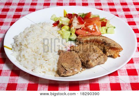 Meats, Rice And Vegetables On White Plate.