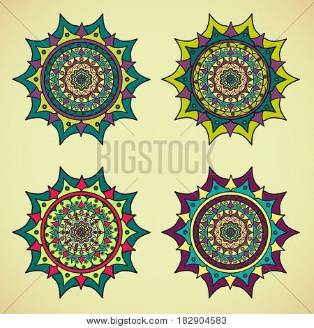 Four colored mandalas on a on light background