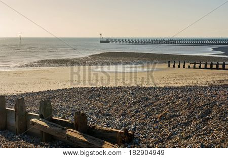 Sand and shingle beach with groynes at Littlehampton West Sussex England