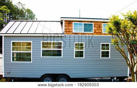 Tiny house for sale on a lot.