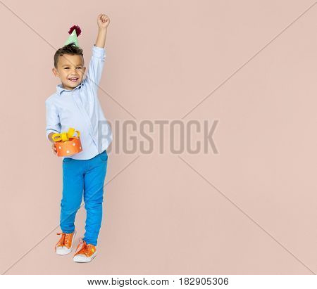 Little Boy Wearing Party Hat Hand Holding Gift Studio Portrait