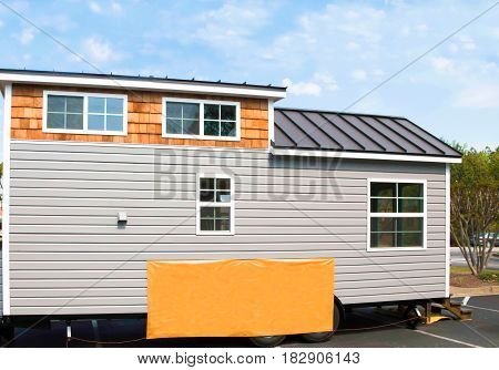 Tiny home for sale on a lot.