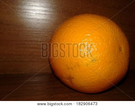 Orange - edible fruit of an evergreen tree orange berry. There is a different size, shape and color of the skin from light yellow to reddish-orange fruit