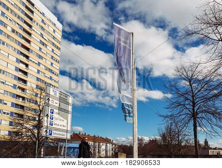 KEHL GERMANY - FEB 3 2016: Traditional German architecture and Welcome to Kehl flags waving at the entrance of the border city of kehl near the Franco German border. Kehl is a town in southwestern Germany in the Ortenaukreis Baden-Württemberg. It is locat