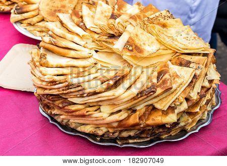 Russian traditional food. Appetizing fried pancakes during Pancake Week