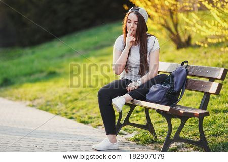 Young Girl Smoke Cigarette At Park With Sunset