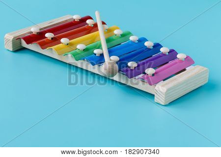 Bright Glockenspeil For Kids Isolated On Aquamarine Background