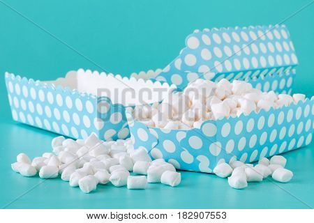Colorful Candy Background. Small Colored Marshmallows Blue Table. Celebration Concept