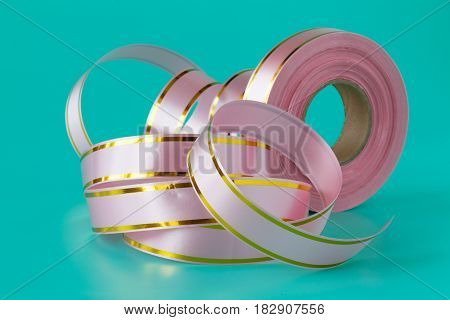 Colorful Streamers Ribbon Tape On Aquamarine Background