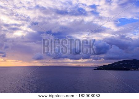 Beautiful sunset in St Maarten near island in caribbean sea