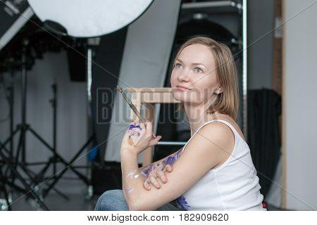 Female Artist With Short Blonde Hair