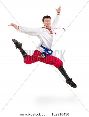 young man wearing a folk costume jumping against isolated white background with copyspace