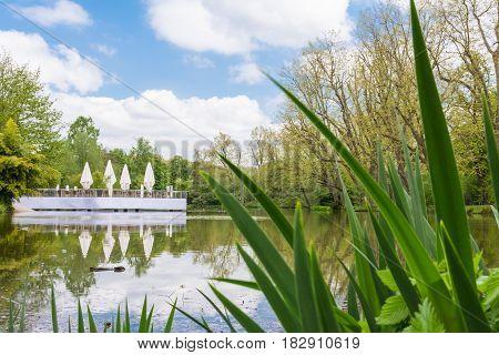 Tranquil Daytime Landscape Lake Pond Restaurant Cafe Peaceful White Clouds Umbrellas