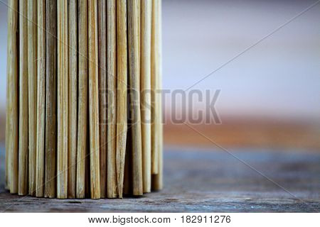 Bamboo toothpicks on wood texture, Close-up, Abstract bamboo