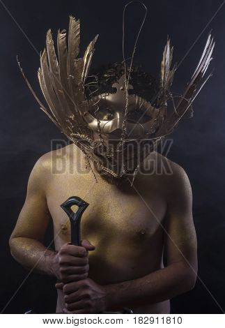 Golden fantasy warrior, man with sword with gold skin covered