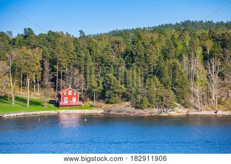 Coastal Village With Red Wooden House