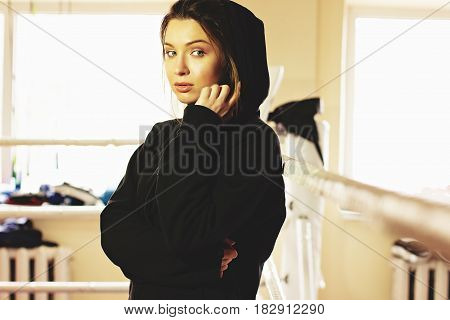 Portrait Of Beautiful Boxing Girl Posing In The Ring. Training At The Gym. Sporty Female Doing Boxin