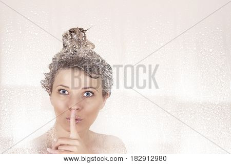 woman in the shower washes her head and secrets.