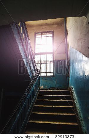 Inside abandoned manor or mansion, Stairs, steps, large window, Vertical image