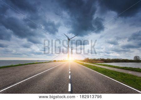 Beautiful Asphalt Road With Wind Turbines