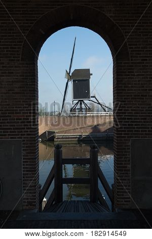 Small river harbor drawbrige and windmill in Heusden - old village in Brabant the Netherlands