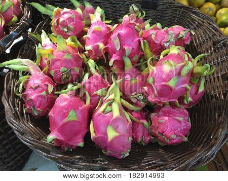 Dragon fruit in a basket. Wait for someone to buy in the supermarket.