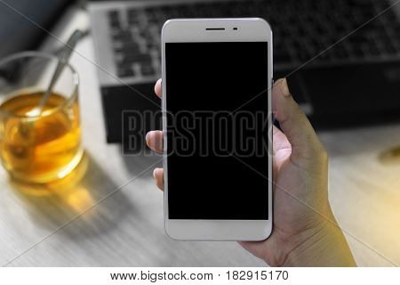 Close-up woman's hand holding a smartphone, Online shopping concept