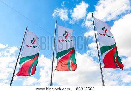 Samara Russia - May 22 2016: Dealership flags of oil company Tatneft against the blue sky. Tatneft is one of the russian oil companies